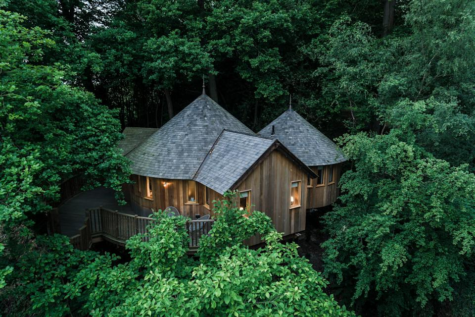 """<strong><a href=""""http://airbnb.pvxt.net/n11KPo"""" rel=""""nofollow noopener"""" target=""""_blank"""" data-ylk=""""slk:The Buzzardry Woodland Treehouse, East Sussex"""" class=""""link rapid-noclick-resp"""">The Buzzardry Woodland Treehouse, East Sussex </a></strong><br><br>This two-bedroom treehouse sleeps up to four people in comfort. The master bedroom has a copper bathtub with views over the treetops, and there's a decked terrace for alfresco dining.<br><br><em>From £300 per night</em>"""