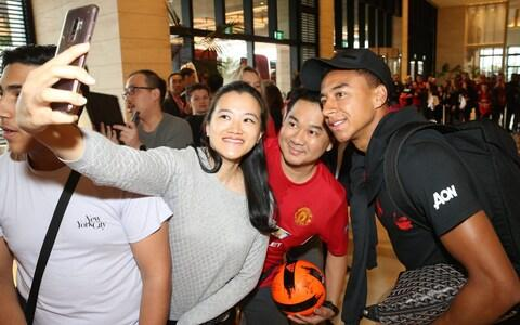 Jesse Lingard of Manchester United signs autographs as the players they leave the team hotel as part of their pre-season tour of Australia, Singapore and China at WACA on July 18, 2019 in Perth, Australia - Credit: Getty Images