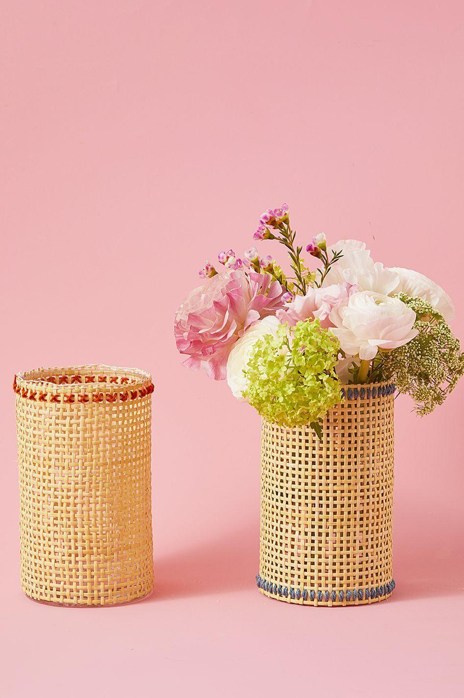<p>Spruce up a plain glass vase to make your mom's fresh flowers really stand out. To make, cut a piece of cane webbing to fit around a glass hurricane vase. Thread a needle with contrasting yarn or embroidery thread and stitch a line or criss-cross pattern along the edges of the cane webbing. Wrap the webbing around the vase and adhere with hot glue.</p>