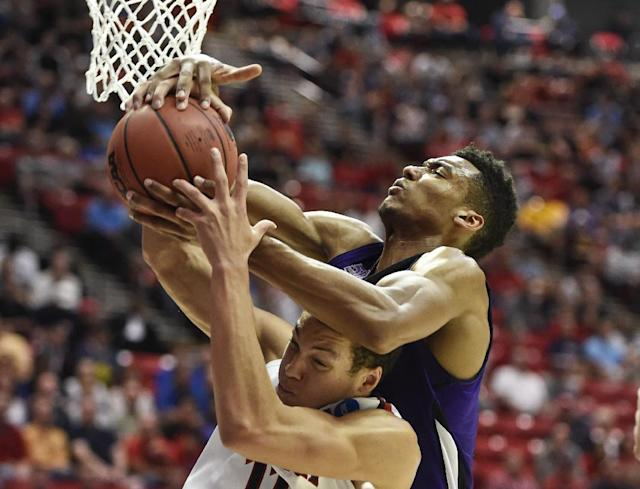 Weber State's Joel Bolomboy goes over Arizona's Aaron Gordon while battling for a rebound during the first half in a second-round game in the NCAA college basketball tournament Friday, March 21, 2014, in San Diego. (AP Photo/Denis Poroy)