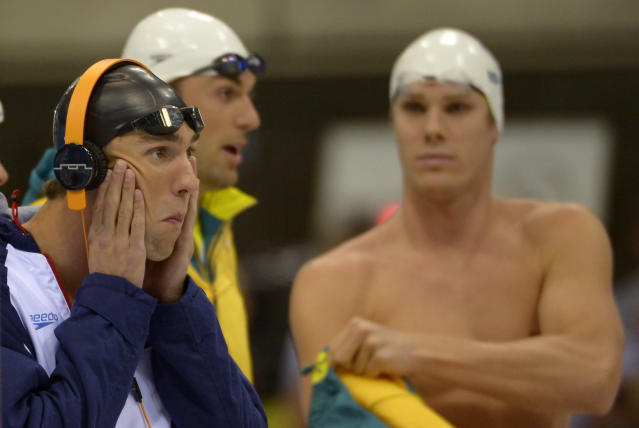 United States' Michael Phelps, left, prepares for the men's 4x100-meter freestyle relay final at the Aquatics Centre in the Olympic Park during the 2012 Summer Olympics in London, Sunday, July 29, 2012. (AP Photo/Mark J. Terrill)