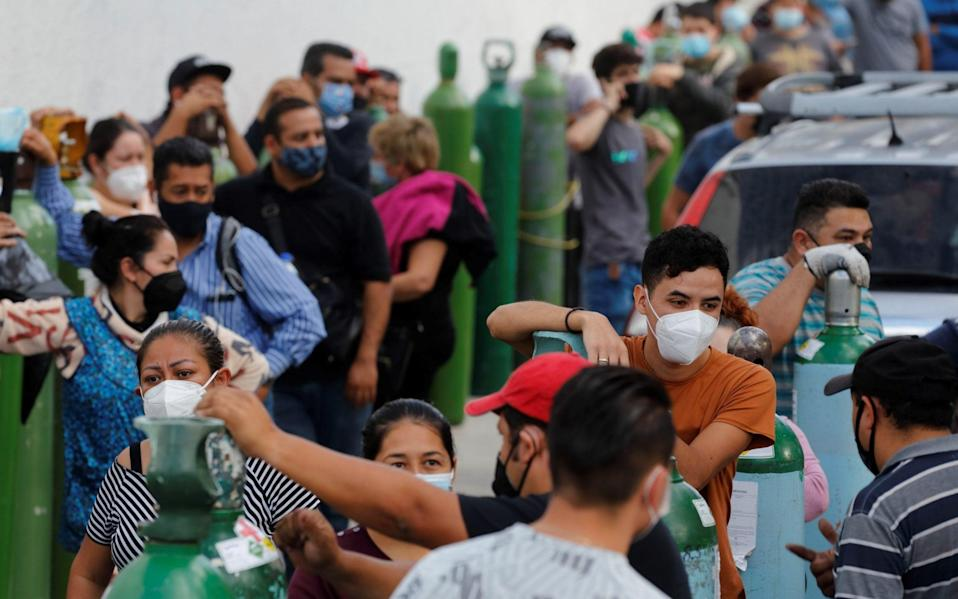 People wait for their turn to fill oxygen tanks in Guadalajara, Jalisco, Mexico - Francisco Guasco/EPA-EFE/Shutterstock