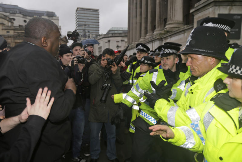 "Photographers bear witness as British police officers confront with people gathered in central London's Trafalgar square, Saturday, April 13, 2013, for a party to mark the death of former British Prime Minister Margaret Thatcher. Margaret Thatcher, the combative ""Iron Lady"" who transformed her country by a ruthless dedication to free market economy during her 11-years as prime minister, died Monday, April 8, 2013. She was 87. (AP Photo/Lefteris Pitarakis)"