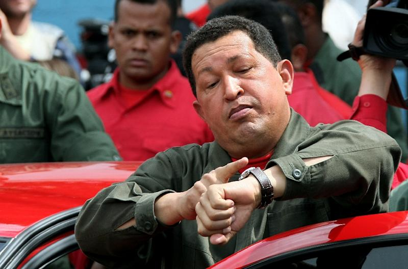 The move, effective May 1, will scrap a half-hour subtraction to the clocks Venezuela's late former president Hugo Chavez (pictured) introduced in 2007 (AFP Photo/Thomas Coex)