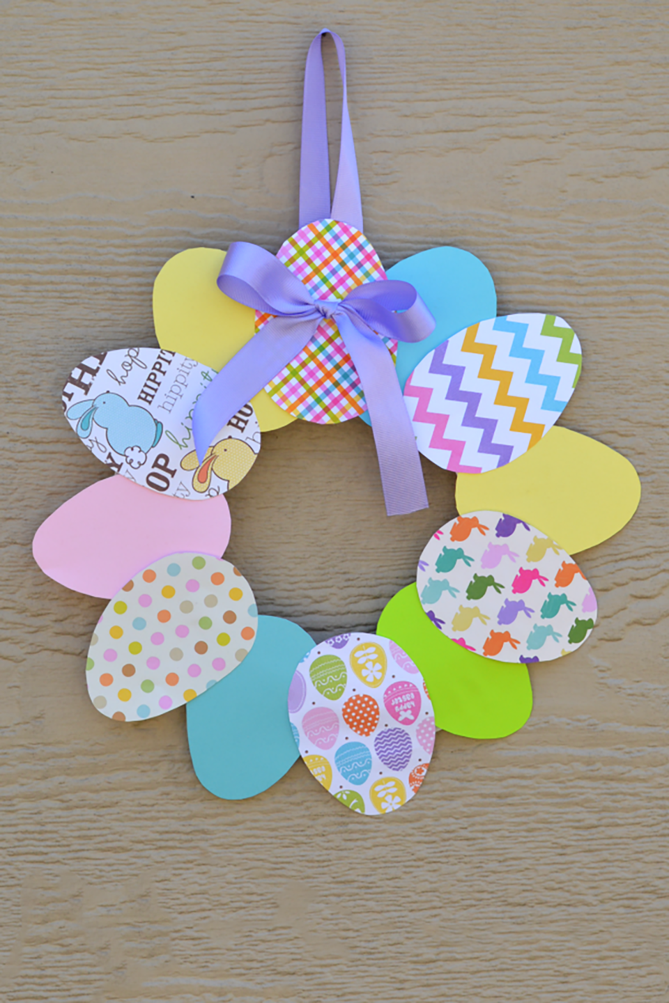 """<p>Supplies for this wreath will cost you less than $5, and you'll love how the spring colors brighten your home.</p><p><strong>Get the tutorial at <a href=""""http://www.theresourcefulmama.com/easy-paper-easter-wreath/"""" rel=""""nofollow noopener"""" target=""""_blank"""" data-ylk=""""slk:The Resourceful Mama"""" class=""""link rapid-noclick-resp"""">The Resourceful Mama</a>.</strong></p>"""