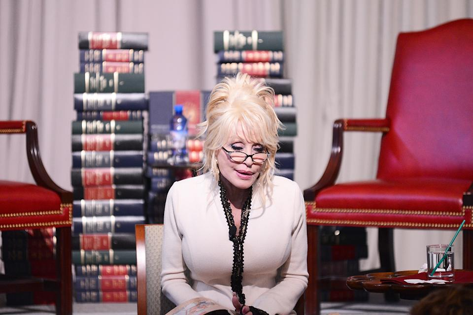 """Singer Dolly Parton reads her book, """"The Coat of Many Colors"""" to schoolchildren at The Library of Congress on February 27, 2018 in Washington, DC.  (Photo by Shannon Finney/Getty Images)"""