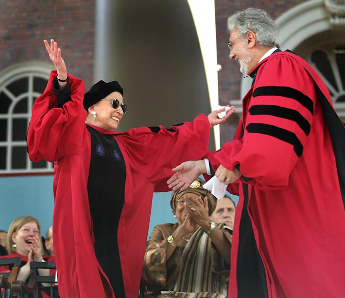 While standing to receive her honorary degree from Harvard University, U.S. Supreme Court Associate Justice Ruth Bader Ginsburg was treated to a serenade from Spanish tenor Placido Domingo after he received his honorary degree. Sitting between them is commencement speaker and honorary degree recipient Ellen Johnson Sirleaf, president of Liberia. (Photo: Pat Greenhouse/Boston Globe via Getty)