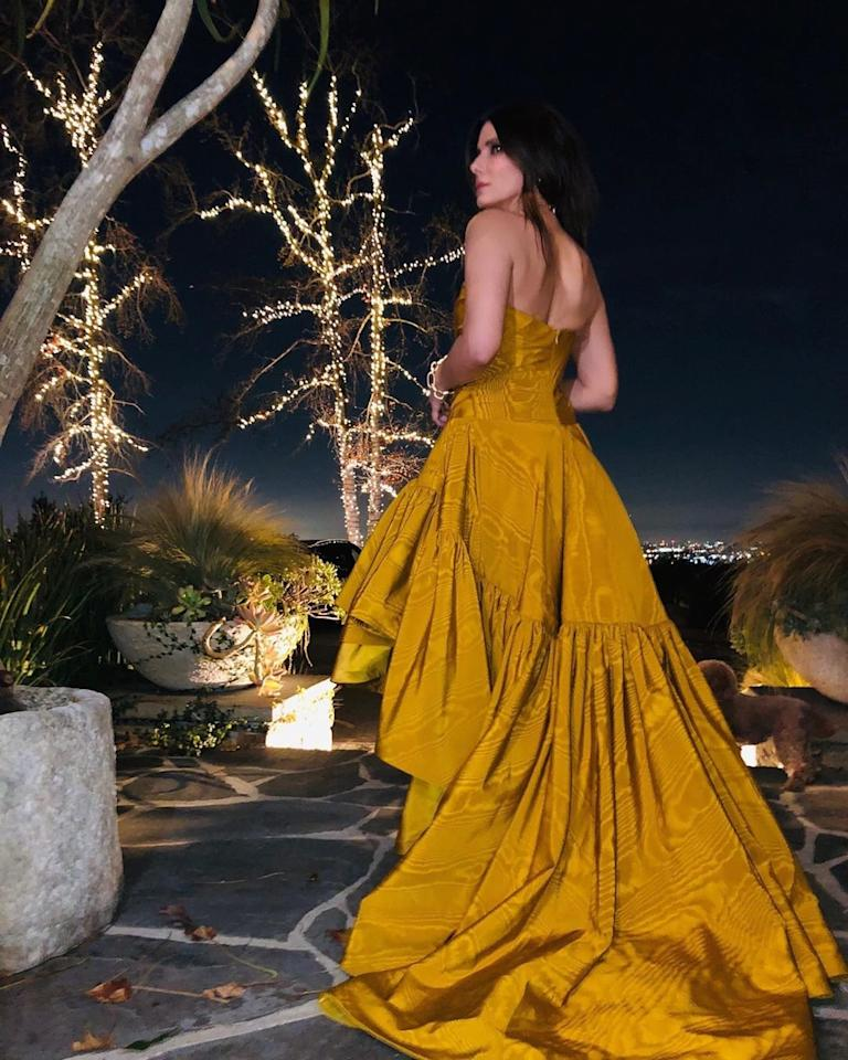 """One trick to getting incredible Instagram photos every time? Date a photographer! Sandra Bullock's <a href=""""https://people.com/celebrity/sandra-bullock-dating-los-angeles-photographer-bryan-randall/"""">boyfriend</a> of nearly five years snapped this stunning shot of her in a strapless golden gown on the night of the 2020 Golden Globes, where she presented the final award of the night."""