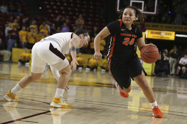 Oregon State's Destiny Slocum (24) drives to the basket after faking out Arizona State's Robbi Ryan during the first half of an NCAA college basketball game Sunday, Jan. 12, 2020, in Tempe, Ariz. (AP Photo/Darryl Webb)