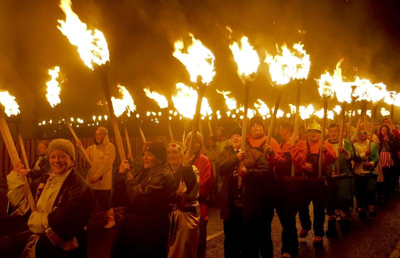 In this photo taken March 14, 2014, locals dressed as Vikings carry torches as they take part in the annual Up Helly Aa, Viking fire festival in Gulberwick, Shetland Islands north of mainland Scotland. The fearsome-looking participants in the festival live in Scotland's remote Shetland Islands, a wind-whipped northern archipelago where many claim descent from Scandinavian raiders. They are cool to the idea of Scotland leaving Britain to form an independent nation, and determined that their rugged islands will retain their autonomy whatever the outcome of September's referendum. (AP Photo/Jill Lawless)