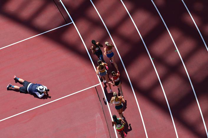 <p>Athletes compete in the women's 3000m steeplechase heats during the Tokyo 2020 Olympic Games at the Olympic Stadium in Tokyo on August 1, 2021. (Photo by Antonin THUILLIER / AFP)</p>