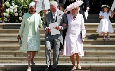 Doria Ragland, mother of the bride, the Prince of Wales and the Duchess of Cornwall walk down the steps of St George's Chapel - Credit: Jane Barlow/Reuters