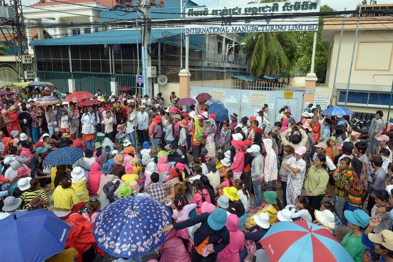 Cambodian garment factory workers block a street during a protest in front of a factory in Phnom Penh on June 19, 2013
