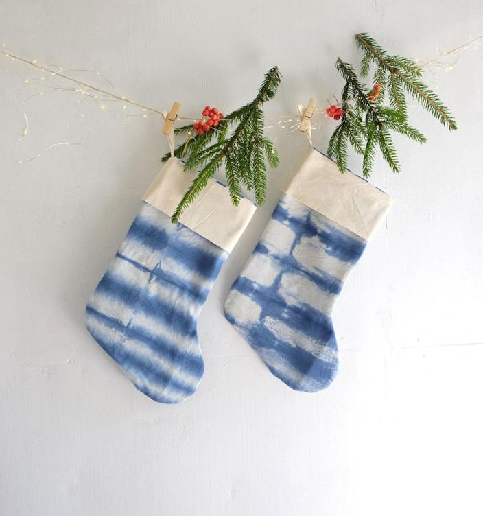 """Basic stockings? Not in this house. Gift your family these hand-dyed stockings that come with a personalized letter tag of your choice, and are packaged in eco-friendly gift wrapping. Throw in some <a href=""""https://www.glamour.com/gallery/holiday-gifts-under-25-dollars?mbid=synd_yahoo_rss"""" rel=""""nofollow noopener"""" target=""""_blank"""" data-ylk=""""slk:stocking stuffers"""" class=""""link rapid-noclick-resp"""">stocking stuffers</a> to complete the gift. $50, Etsy. <a href=""""https://www.etsy.com/listing/853466627/personalized-tie-dye-christmas-stockings"""" rel=""""nofollow noopener"""" target=""""_blank"""" data-ylk=""""slk:Get it now!"""" class=""""link rapid-noclick-resp"""">Get it now!</a>"""