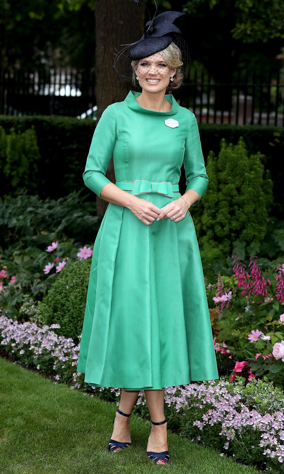 <p>We're big fans of Charlotte's classic, midi dress and navy hat combo. Understated and elegant. <em>[Photo: PA]</em> </p>