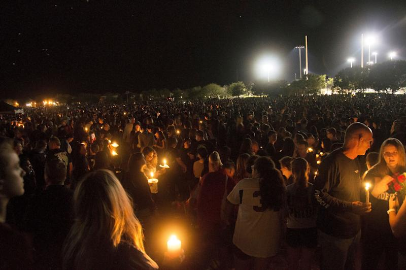 Thousands of community members gather to mourn those who died in Wednesday's school shooting in Parkland, Florida.