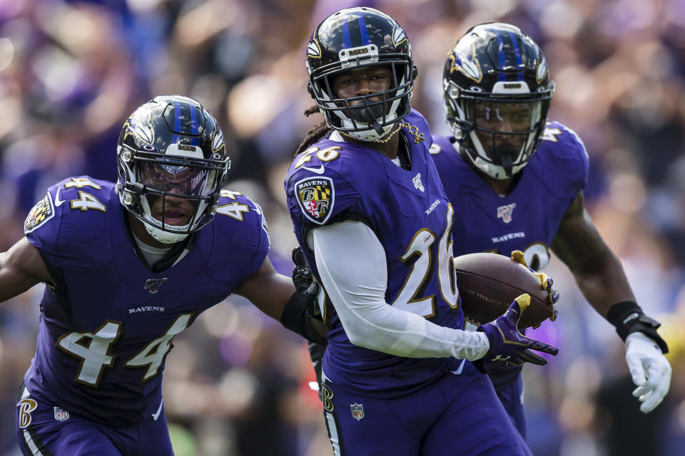 Maurice Canady #26 of the Baltimore Ravens celebrates with Chris Board #49 and Marlon Humphrey #44