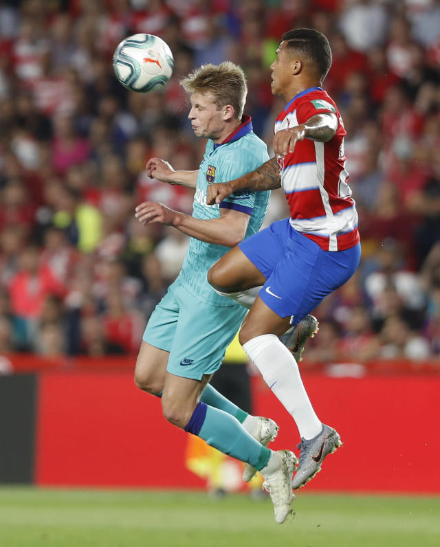 Barcelona's De Jong, left, and Granada's Yangel Herrera jump for the ball during the Spanish La Liga soccer match between Barcelona and Granada at the Los Carmenes stadium in Granada, Spain, Saturday, Sep. 21, 2019. (AP Photo/Miguel Morenatti)