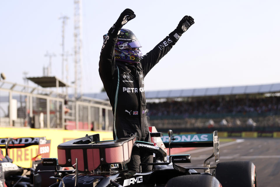 Mercedes driver Lewis Hamilton of Britain celebrates after clocking the fastest time in the qualifying session ahead of Sunday's British Formula One Grand Prix, at the Silverstone circuit, in Silverstone, England, Friday, July 16, 2021. (Lars Baron/Pool photo via AP)