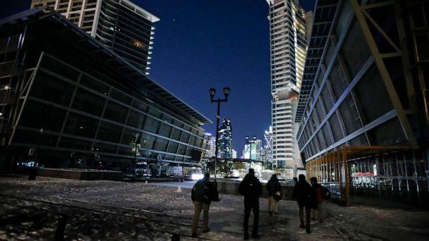 PHOTO: Due to a shortage of electricity in the region, the lights and screens in front of American Airlines Center are turned off on Feb. 15, 2021, saving electricity resources in Dallas.  (Brandon Wade/AP)