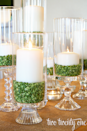 """<p>Dried split peas give these centerpieces a pop of vibrant color.</p><p><strong>Get the tutorial at <a href=""""http://www.twotwentyone.net/thrifty-hurricane-tutorial/"""" rel=""""nofollow noopener"""" target=""""_blank"""" data-ylk=""""slk:Two Twenty One"""" class=""""link rapid-noclick-resp"""">Two Twenty One</a>. </strong></p><p><a class=""""link rapid-noclick-resp"""" href=""""https://www.amazon.com/WGV-Clear-Cylinder-5-Inch-12-Inch/dp/B008NUQGX4/ref=sr_1_2?tag=syn-yahoo-20&ascsubtag=%5Bartid%7C10050.g.4036%5Bsrc%7Cyahoo-us"""" rel=""""nofollow noopener"""" target=""""_blank"""" data-ylk=""""slk:SHOP VOTIVES"""">SHOP VOTIVES</a></p>"""