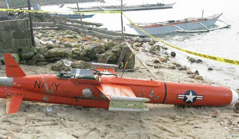 A US drone lying along the beach in San Jacinto town, Masbate province, on January 8, 2013