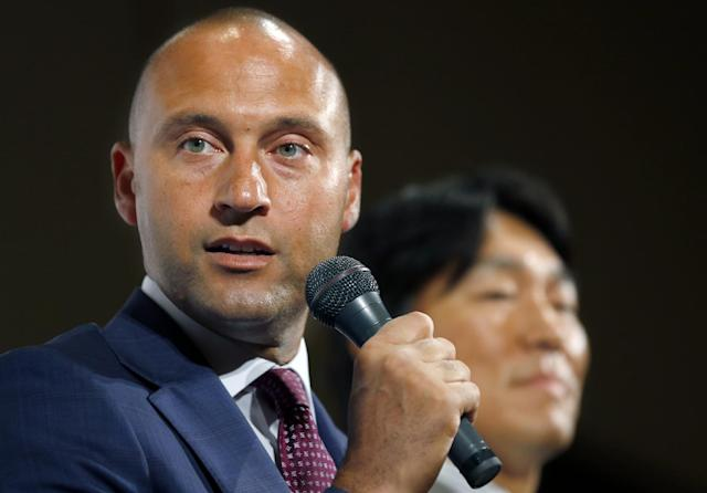 Former NY Yankees Derek Jeter, left, speaks during a press conference with Hideki Matsui on a charity baseball game in Tokyo, Wednesday, March 18, 2015. Jeter is teaming up with Matsui to support the survivors of the 2011 earthquake and tsunami - and hinted he may someday get back into baseball as a team owner. The event will be held on Sunday at Tokyo Dome. (AP Photo/Shizuo Kambayashi)