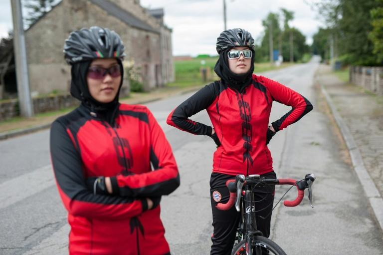 Masomah (R) and Zahra Alizada fled a daily life of insults, threats and attacks to pursue a passion for cycling inherited from their father