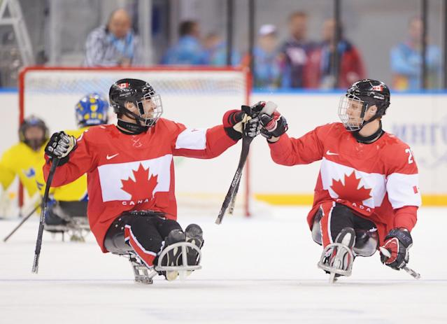 SOCHI, RUSSIA - MARCH 08: Dominic Larocque (R) of Canada celebrates with team mate Kevin Rempel after scoring during the Preliminary Round Group A match between Canada and Sweden at Shayba Arena on March 8, 2014 in Sochi, Russia. (Photo by Dennis Grombkowski/Getty Images)