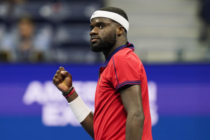 Frances Tiafoe, of the United States, reacts after winning the second game in the fifth set against Andrey Rublev, of Russia, at the third round of the US Open tennis championships, Saturday, Sept. 4, 2021, in New York. (AP Photo/Frank Franklin II)