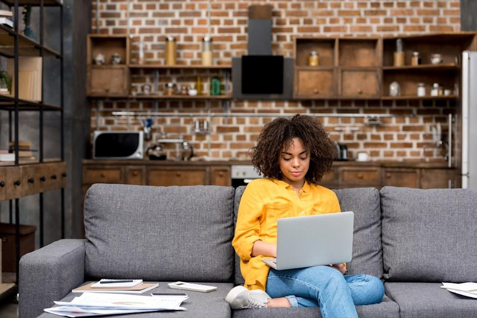 Woman working on her couch
