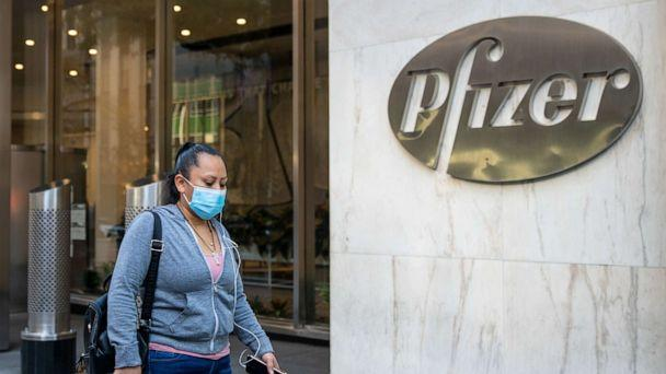 PHOTO: People walk by the Pfizer headquarters, Nov. 9, 2020, in New York.  (David Dee Delgado/Getty Images)