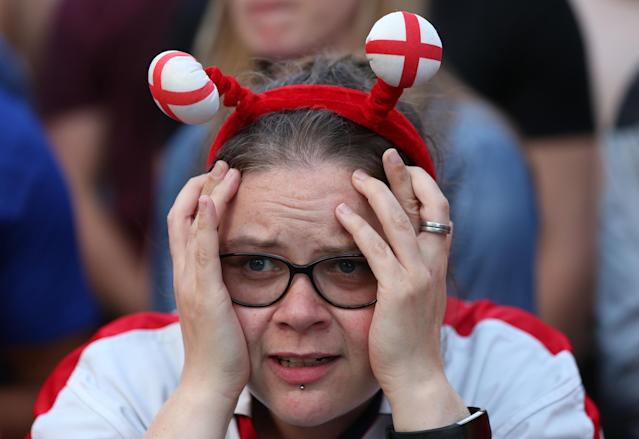 An England fan is beside herself.
