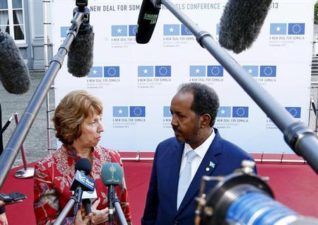 European Union foreign policy chief Ashton and Somali's President Sheikh Mohamud talk to reporters ahead of a conference called New Deal in Somalia in Brussels