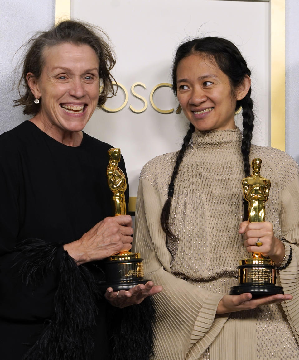 "Producers Frances McDormand, left, and Chloe Zhao, winners of the award for best picture for ""Nomadland,"" pose in the press room at the Oscars on Sunday, April 25, 2021, at Union Station in Los Angeles. (AP Photo/Chris Pizzello, Pool)"