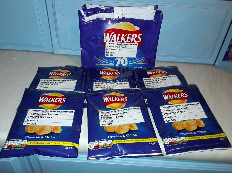 <em>Environmental campaigners have been posting empty packets of Walkers' crisps in protest at the packaging (Twitter/@MarvinE0)</em>
