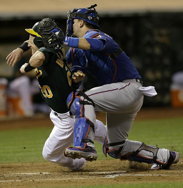 Texas Rangers catcher A.J. Pierzynski, right, tags out Oakland Athletics' Josh Donaldson (20) at home plate during the third inning of a baseball game in Oakland, Calif., Tuesday, Sept. 3, 2013. (AP Photo/Jeff Chiu)