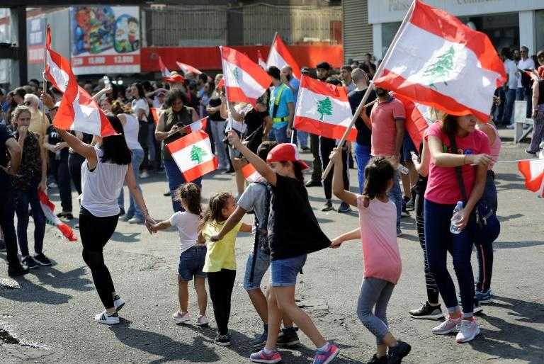 Lebanese schoolchildren have joined the protests that have rocked the country since October 17, demanding better public education and more job opportunities for school leavers (AFP Photo/JOSEPH EID)