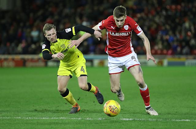 "Soccer Football - Championship - Barnsley vs Burton Albion - Oakwell, Barnsley, Britain - February 20, 2018 BarnsleyÕs Joe Williams in action with Burton AlbionÕs Jamie Allen Action Images/John Clifton EDITORIAL USE ONLY. No use with unauthorized audio, video, data, fixture lists, club/league logos or ""live"" services. Online in-match use limited to 75 images, no video emulation. No use in betting, games or single club/league/player publications. Please contact your account representative for further details."