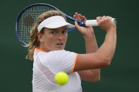 Coco Vandeweghe of the US plays a return to Belarus's Olga Govortsova during the women's singles first round match on day three of the Wimbledon Tennis Championships in London, Wednesday June 30, 2021. (AP Photo/Kirsty Wigglesworth)