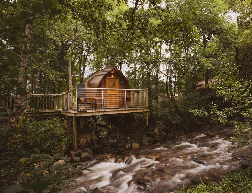 """<p>For something that's not quite a five-star hotel yet not quite camping, try glamping at one of <a href=""""https://go.redirectingat.com?id=127X1599956&url=https%3A%2F%2Fwww.booking.com%2Fhotel%2Fgb%2Friverbeds.en-gb.html%3Faid%3D1922306%26label%3Dbest-hotels-scotland&sref=https%3A%2F%2Fwww.goodhousekeeping.com%2Fuk%2Flifestyle%2Ftravel%2Fg35120921%2Fbest-hotels-in-scotland%2F"""" rel=""""nofollow noopener"""" target=""""_blank"""" data-ylk=""""slk:RiverBeds"""" class=""""link rapid-noclick-resp"""">RiverBeds</a>'s """"wee lodges"""" in beautiful Glencoe.</p><p>Each en-suite cabin comes with a hot tub, a kitchenette and a private veranda perched above a river. Rustic while luxurious, staying here is ideal for anyone who seeks to connect with nature – albeit with their creature comforts.</p><p><a class=""""link rapid-noclick-resp"""" href=""""https://go.redirectingat.com?id=127X1599956&url=https%3A%2F%2Fwww.booking.com%2Fhotel%2Fgb%2Friverbeds.en-gb.html%3Faid%3D1922306%26label%3Dbest-hotels-scotland&sref=https%3A%2F%2Fwww.goodhousekeeping.com%2Fuk%2Flifestyle%2Ftravel%2Fg35120921%2Fbest-hotels-in-scotland%2F"""" rel=""""nofollow noopener"""" target=""""_blank"""" data-ylk=""""slk:CHECK AVAILABILITY"""">CHECK AVAILABILITY</a></p>"""