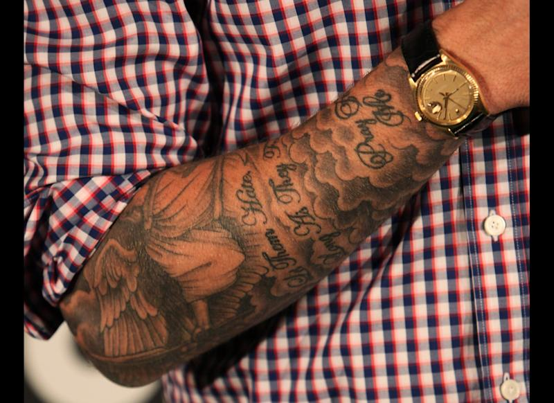 Professional soccer player David Beckham (tattoo detail) attends the press room during the 2nd Annual Cartoon Network Hall of Game Awards at Barker Hangar on February 18, 2012 in Santa Monica, California. (David Livingston, Getty Images)