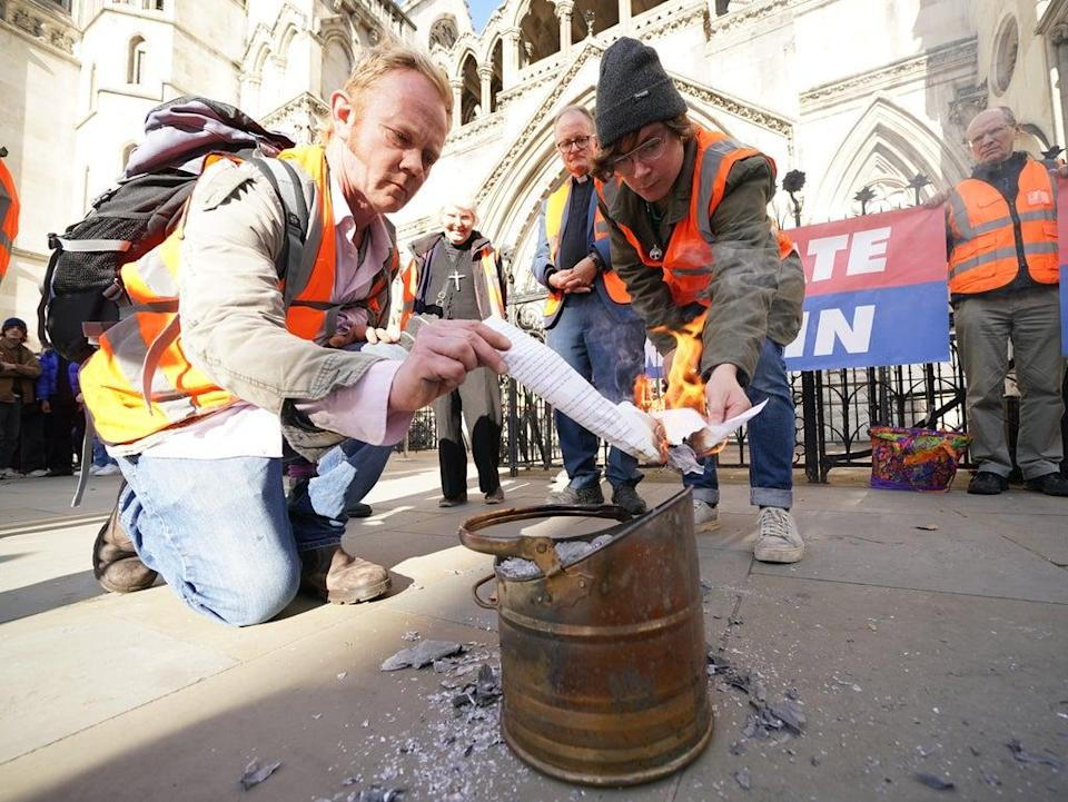 Demonstrators from Insulate Britain outside the High Court (PA) (PA Wire)