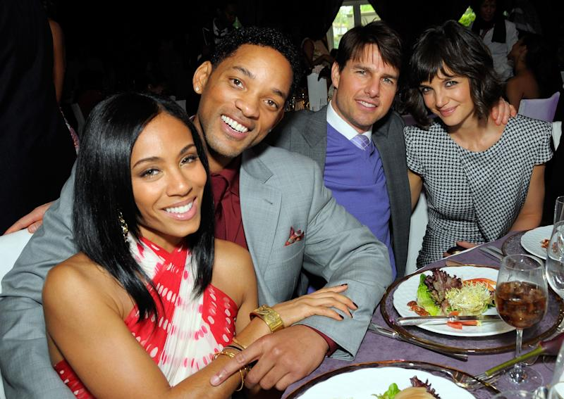 The Smiths sat with friends Tom Cruise and Katie Holmes at a 2008 Hollywood fete. (Photo: Getty Images)