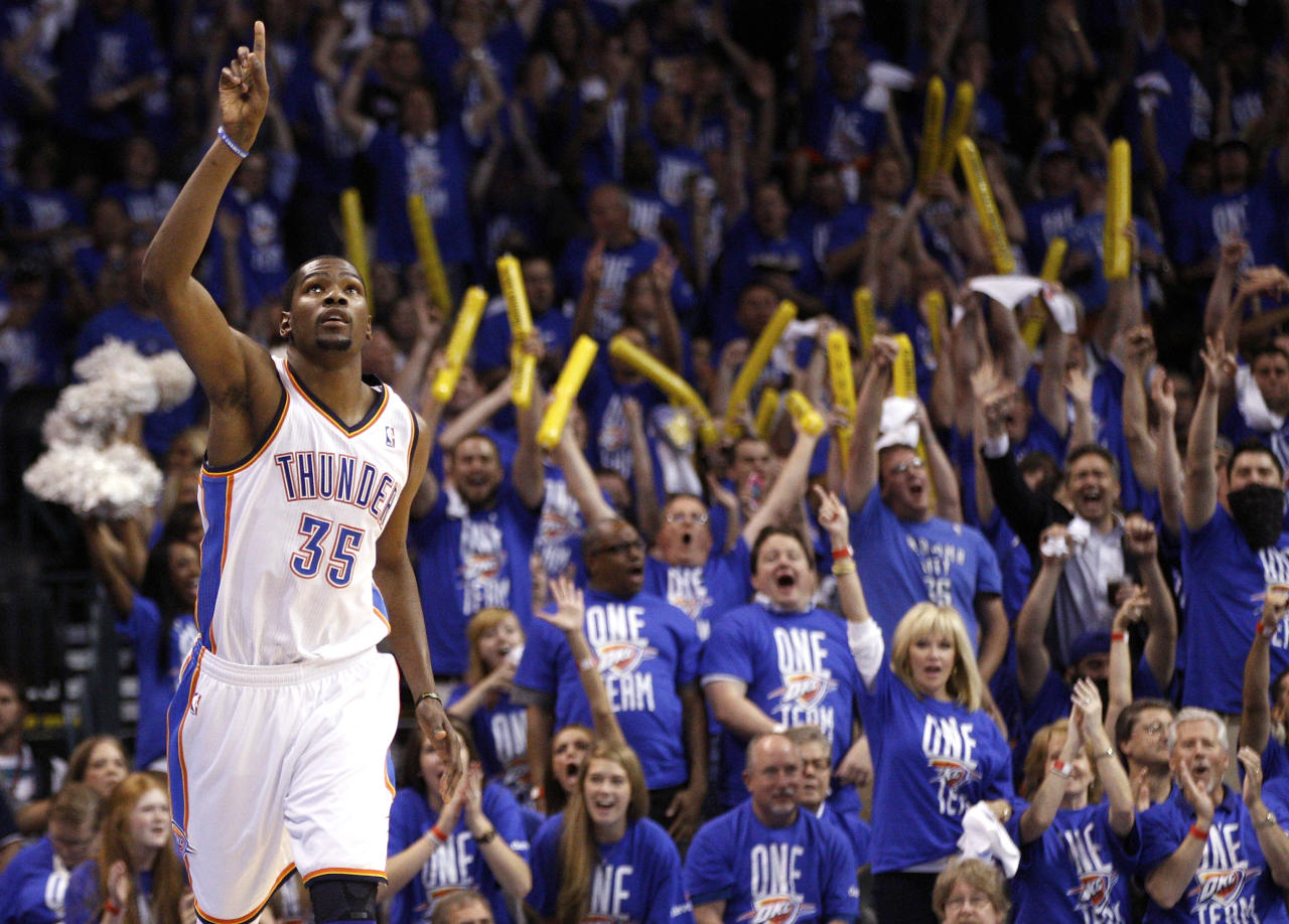 Oklahoma City Thunder forward Kevin Durant reacts after hitting a basket against the Los Angeles Lakers in the third quarter of Game 1 in the second round of the NBA basketball playoffs, in Oklahoma City, Monday, May 14, 2012. (AP Photo/Sue Ogrocki)