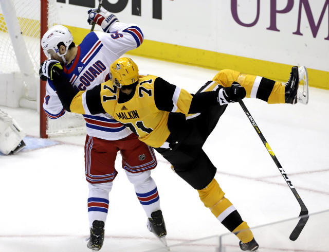 Pittsburgh Penguins' Evgeni Malkin (71) is upended by New York Rangers' Adam McQuaid (54) during the first period of an NHL hockey game in Pittsburgh, Sunday, Feb. 17, 2019. (AP Photo/Gene J. Puskar)