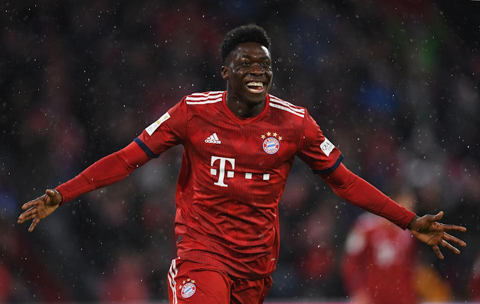 MUNICH, GERMANY - MARCH 17: Alphonso Davies of Bayern Munich celebrates scoring his teams sixth goal of the game during the Bundesliga match between FC Bayern Muenchen and 1. FSV Mainz 05 at Allianz Arena on March 17, 2019 in Munich, Germany. (Photo by Christian Kaspar-Bartke/Bongarts/Getty Images)