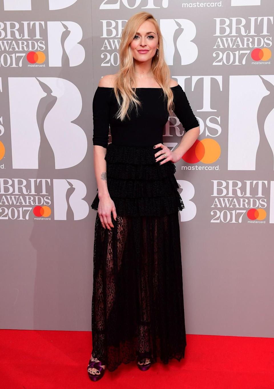 <p>Fearne opted for a lacy black gown. <i>[Photo: PA]</i> </p>