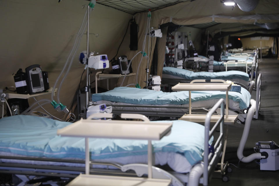 Beds line up inside the military field hospital built in Mulhouse, eastern France, Monday March 23, 2020. The Grand Est region is now the epicenter of the outbreak in France, which has buried the third most virus victims in Europe, after Italy and Spain. For most people, the new coronavirus causes only mild or moderate symptoms. For some it can cause more severe illness. (AP Photo/Jean-Francois Badias)