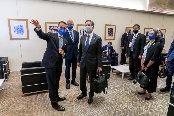 U.S. Secretary of State Antony Blinken, center, speaks with Italy's Foreign Minister Luigi Di Maio, left, as he arrives at a G20 foreign ministers meeting in Matera, Italy, Tuesday, June 29, 2021. Blinken is on a week long trip in Europe traveling to Germany, France and Italy. (AP Photo/Andrew Harnik, Pool)